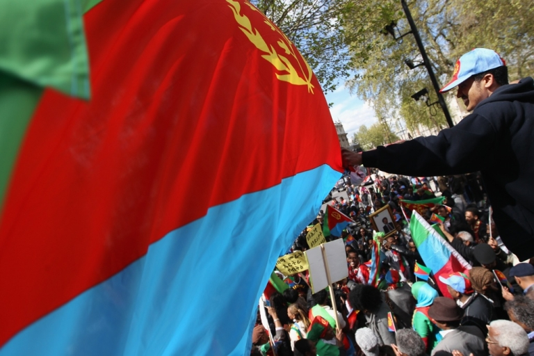 <p>An Eritrean demonstrator waves his national flag while taking part in a demonstration on Whitehall on April 30, 2012 in London, England.</p>