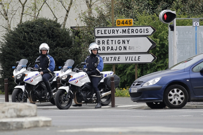 <p>French motorcycle police officers survey traffic on April 7, 2012 in Viry-Chatillon, south of Paris.</p>