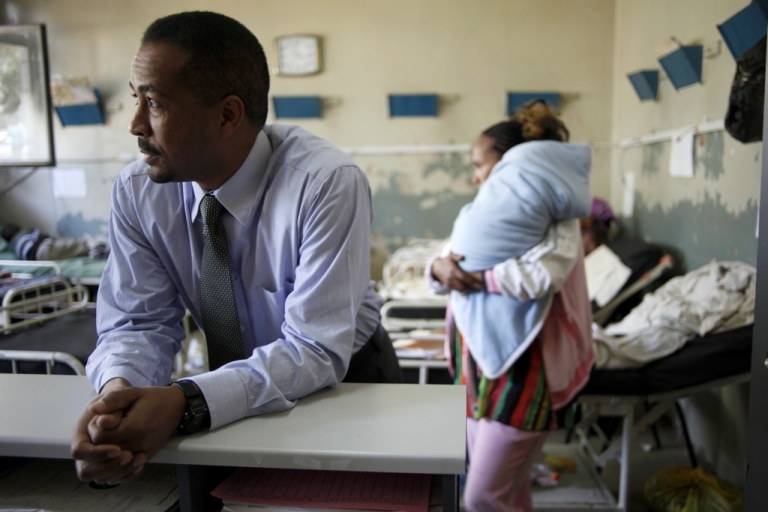 <p>Solomon Zewdu M.D., the country director of Ethiopia for Johns Hopkins Bloomberg School of Public Health, listens to a nurse in the children's ward at Black Lion Hospital in Addis Ababa, Ethiopia on April 5, 2011.</p>