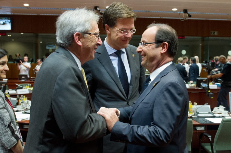<p>Luxembourg Prime Minister Jean-Claude Juncker (L), Dutch Prime Minister Mark Rutte talk with French President Francois Hollande prior to a second day of European Union leaders summit in Brussels on June 29, 2012.</p>