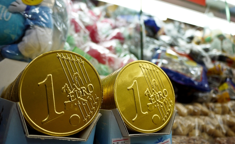 <p>Chocolate euro coins are displayed on a stand at Piazza Navona in central Rome, on Dec. 30, 2011.</p>
