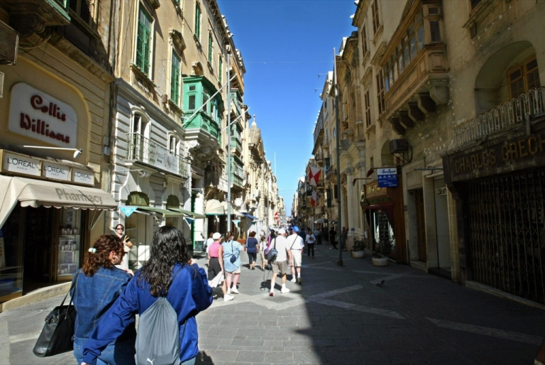 <p>People stroll downtown in La Valette, Malta. If the euro zone were to split apart, what would become of small member states such as Malta?</p>