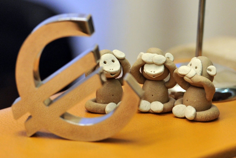 <p>Three monkeys symbolizing ''say nothing, see nothing, hear nothing'' are displayed behind a euro symbol on a desk at the entrance of Luxembourg's prime minister's residence, Hotel de Bourgogne, in Luxembourg on July 14, 2011, before a meeting between Luxembourg Prime Minister and Euro Group president Jean-Claude Juncker and Deutsche Bank chief executive officer Josef Ackermann.</p>