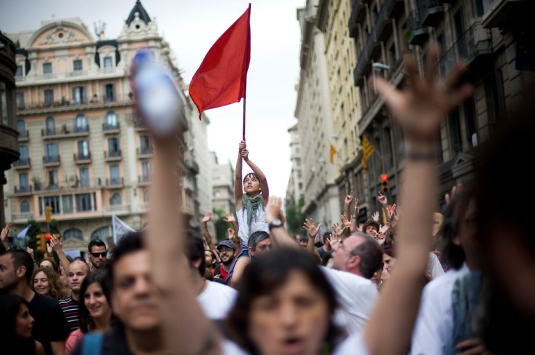 <p>Demonstrators shout slogans during a protest against the euro zone leaders' agreed 'Pact For The Euro' on June 19, 2011 in Barcelona, Spain. Thousands across Spain protested how the country's economic crisis is being handled.</p>