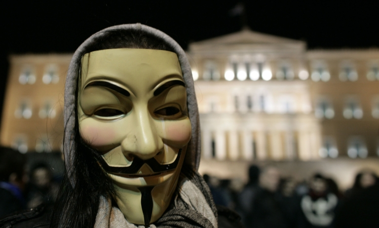 <p>A demonstrator wears an 'anonymous mask' during a protest against austerity measures in front of the Greek Parliament in Athens on February 19. A fifth year of recession is expected to pull the struggling nation's output down 4.4 percent in 2012.</p>