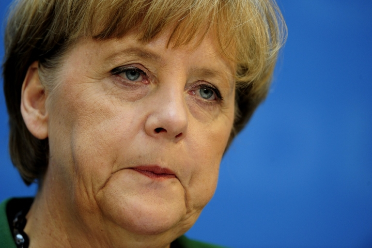 <p>German chancellor Angela Merkel comments on the outcome of regional elections in the northern Schleswig-Holstein state and voting in France and Greece at a press conference on May 7, 2012 in Berlin.</p>