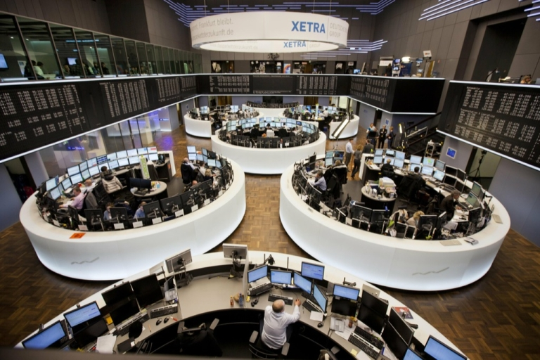 <p>Stock traders work at the Deutsche Boerse in the central German city of Frankfurt am Main after a press conference today. The EU Commission vetoed a transatlantic tie-up of the Frankfurt and New York stock exchanges, a decision slammed here as 'out of touch with reality' and marking a 'dark day' for Europe.</p>