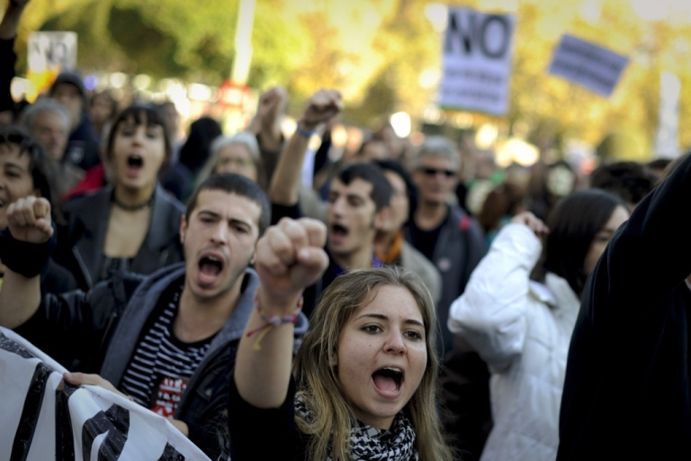 <p>Spain's protesters march through the streets of Madrid to protest spending cuts, high unemployment and political corruption.</p>