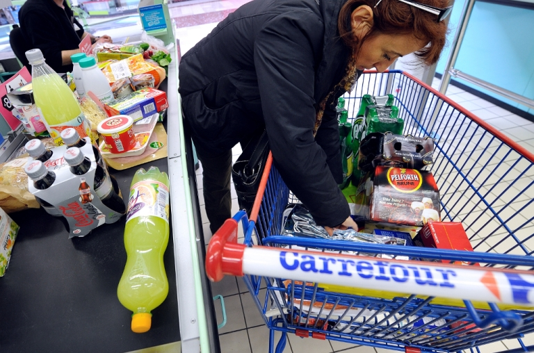 <p>A shopper unloads her cart at a Carrefour in Hazebrouck, France. Carrefour is the largest European retail corporation and is the destination for many shoppers as the obesity levels are exacerbated by the debt crisis.</p>