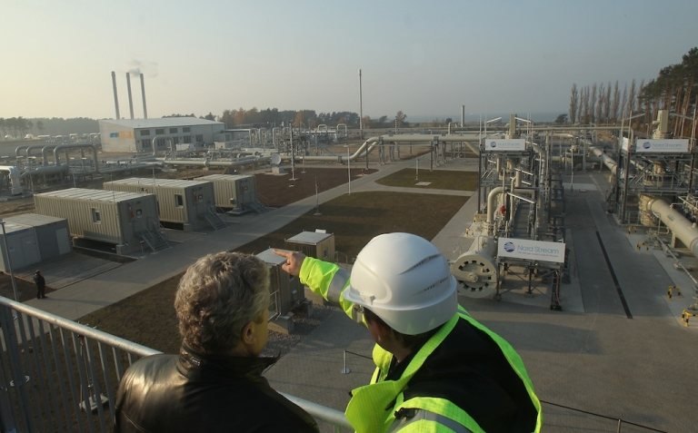 <p>LUBMIN, GERMANY - NOVEMBER 08: A visitor and a worker look out at the central facility where the Nord Stream Baltic Sea gas pipeline reaches western Europe following the pipeline's official inauguration on November 8, 2011 in Lubmin, Germany. (Photo by Sean Gallup/Getty Images)</p>