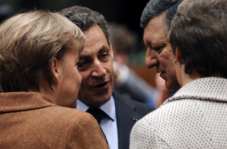 <p>(From L) German Chancellor Angela Merkel, French President Nicolas Sarkozy and European Commission President José Manuel Barroso speak before a working session during a two-day summit at the EU headquarters in Brussels.</p>
