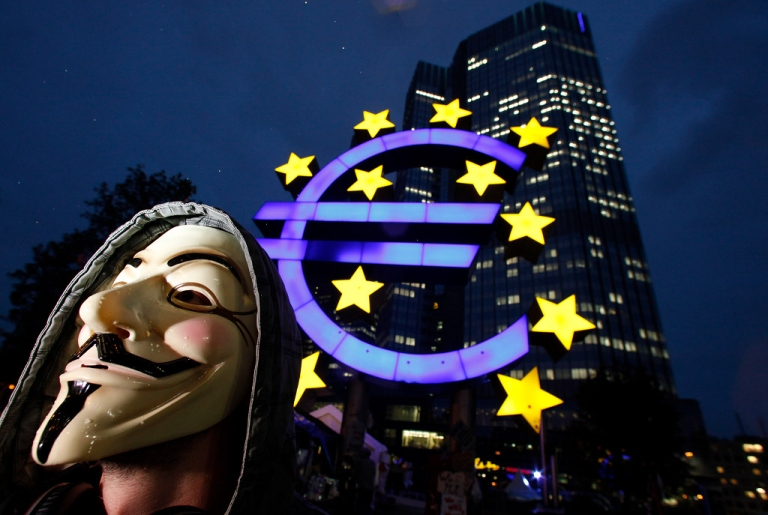 <p>A masked protester, inspired by the Occupy Wall Street protests in the United States stands in front of the headquarters of the European Central Bank (ECB) on October 18, 2011 in Frankfurt am Main, Germany. Around hundred protesters operate a camp outside the ECB to demonstrate against economic and financial policy.</p>