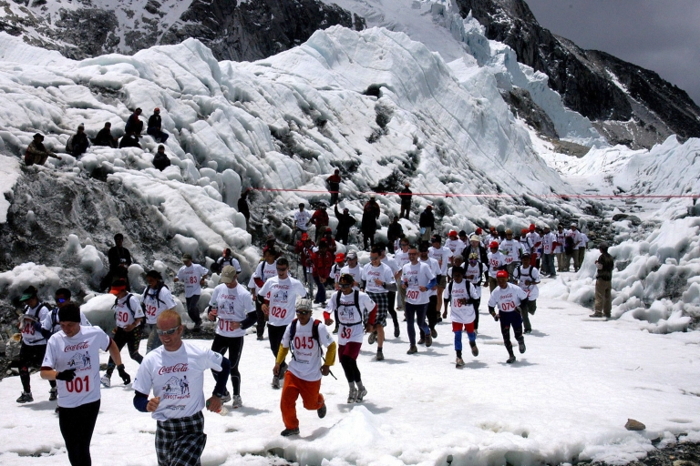 <p>These guys might need a bathroom break... Marathon runners run under a banner at the start of the Everest Hillary Marathon at Everest Base Camp, 29 May 2006. Over 140 marathon runners took part in the race covering 26.2 miles from Everest Base Camp to Namche Bazar from a height of 5,364 meters to 3,446 meters).</p>