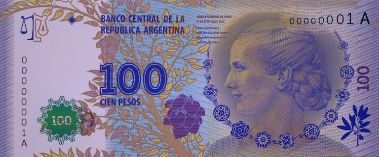 <p>Reproduction of a model of the new 100-peso bill with the portrait of Eva Duarte de Peron, popularly known as Evita, second wife of three-time Argentine President Juan Peron, during a ceremony held at Casa Rosada government house in Buenos Aires on July 25, 2012.</p>