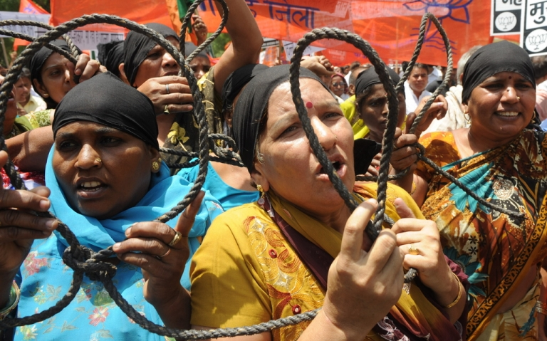 <p>Bhartiya Janata Party (BJP) activists display nooses as they shout slogans against the Congress led UPA government during a protest in New Delhi on May 19, 2010. BJP protesters demanded the execution of Afzal Guru,the prime accused in the Parliament attack case of December 13, 2001.</p>