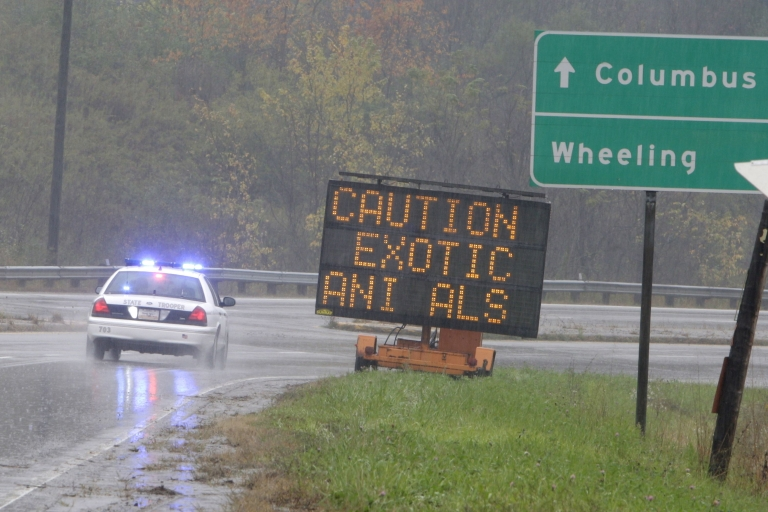 <p>An Ohio State Highway Patrol officer drives past a sign warning of the exotic animals on the loose from a wildlife preserve October 19, 2011 in Zanesville, Ohio.</p>