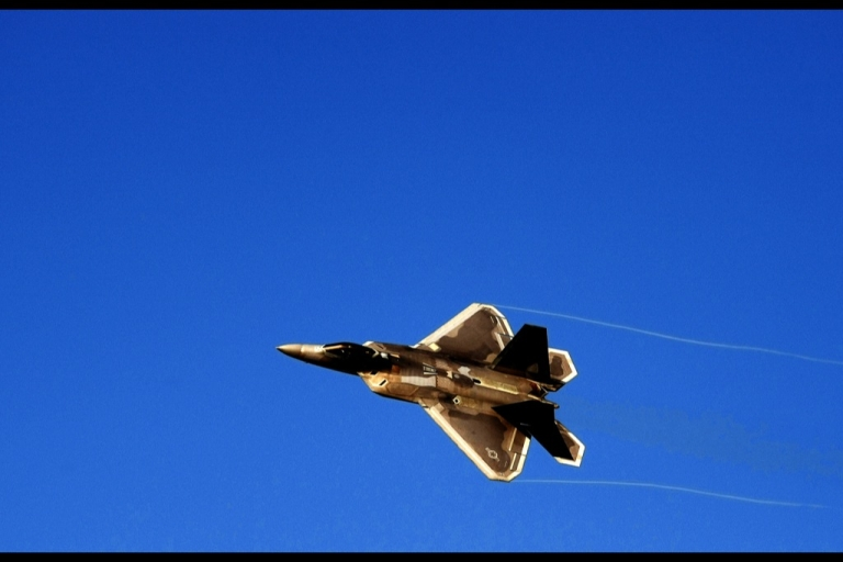 <p>A F-22 flies across the sky at an air show. The problems have been fixed and the aircraft are ready to fly again.</p>