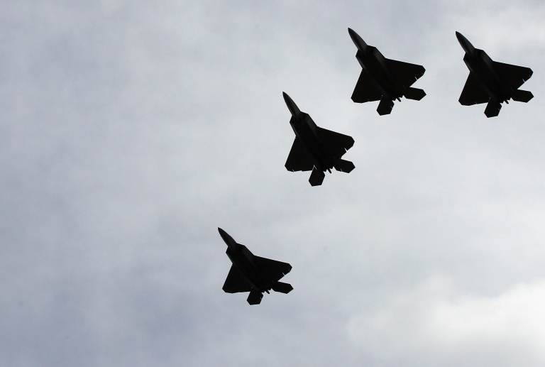 <p>A group of F-22 Raptors perform a flyover during the burial service for former Sen. Ted Stevens (R-Alaska) at Arlington National Cemetery on Sept. 28, 2010.</p>