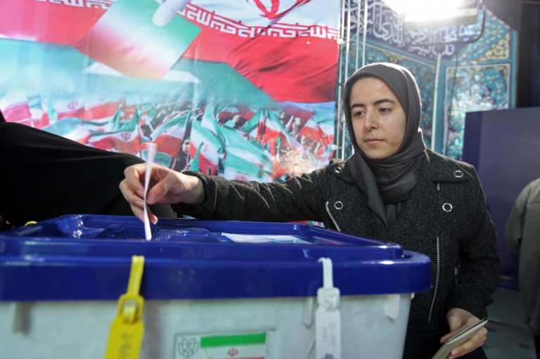 <p>An Iranian woman votes at a polling station in Tehran on March 2, 2012. Iran's 48 million voters are being called on to decide their next parliament today in elections whose turnout will be weighed to give an idea of support for the Islamic republic's regime.</p>
