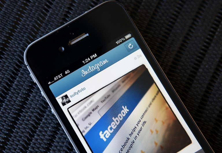 <p>In this photo illustration, an Instagram photo of the Facebook website app is seen on an Apple iPhone on April 9, 2012 in New York City.</p>