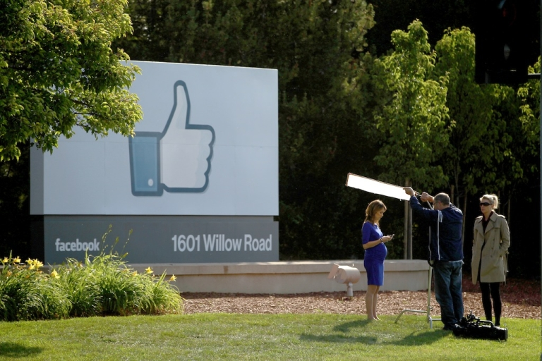 <p>A television crew prepares for a broadcast in front of a 'like' sign outside Facebook headquarters May 18, 2012 in Menlo Park, California. The eight-year-old social network company listed their initial public offering on NASDAQ at $38 a share, a valuation of $104 billion, making its IPO the third largest in U.S. history after General Motors and Visa.</p>