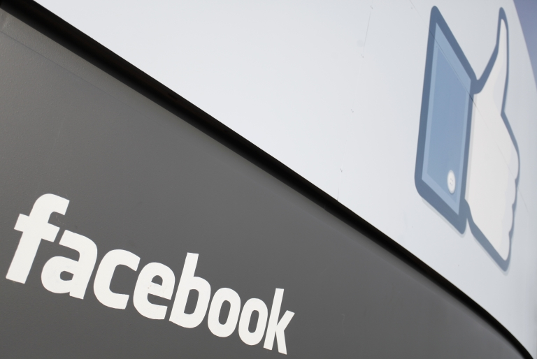 <p>A Facebook sign is seen at the main entrance of Facebook's new headquarters in Menlo Park, Calif. Facebook is set to raise $16 billion in its initial public offering on May 18, 2012, with the social network company valued at $104 billion.</p>