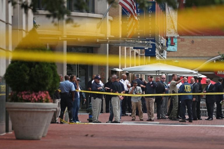 <p>Local and federal investigators gather evidence after a security guard was shot in the arm at the headquarters of the Family Research Council on Aug. 15, 2012, in Washington, DC.</p>