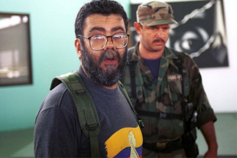 <p>U.S. AND COLOMBIA OUT: Alfonso Cano, the second in command of The Revolutionary Armed Forces of Colombia and head of the new underground Bolivariano Party works in his office December 5, 2000 in San Vicente del Caguan, Colombia.</p>