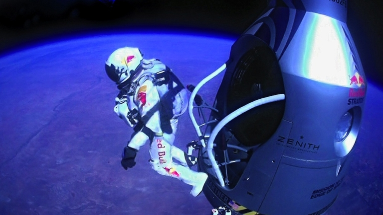 <p>Felix Baumgartner of Austria jumps out of a capsule during the final manned flight for Red Bull Stratos on Oct. 14, 2012, in space. Baumgartner broke the world record for the highest free fall in history after making a 23-mile ascent in the capsule attached to a massive balloon.</p>