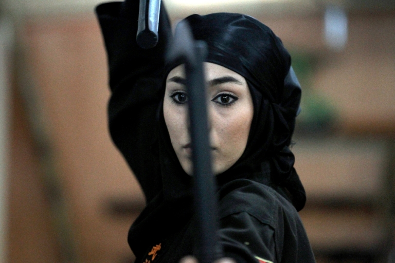 <p>An Iranian female Ninja demonstrates her Ninjutsu skills in a martial arts club during a showcase for the media in the city of Karaj, 40 kms west of the capital Tehran, on March 15, 2012.</p>