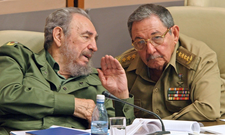 <p>Former Cuban President Fidel Castro, left, and his brother Raúl, chat in Havana, during a meeting of the Cuban parliament in December, 2003.</p>