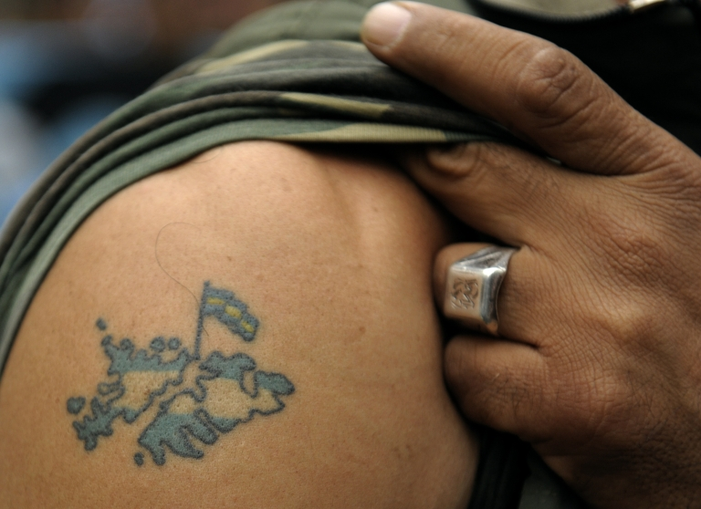 <p>Argentine war veteran Victor Villagra shows his tattoo of the Islas Malvinas, or Falkands Islands in English, during a demonstration near the British Embassy in Buenos Aires in April, 2010.</p>