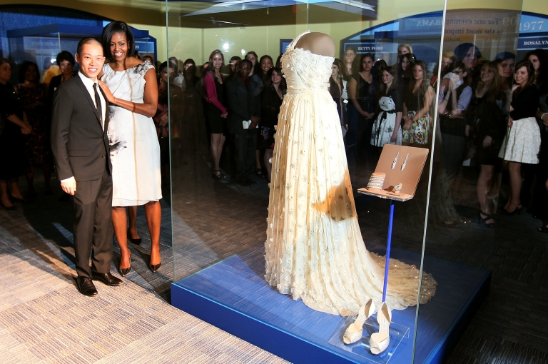<p>First lady Michelle Obama stands with designer Jason Wu in front of her 2009 inaugural gown on Mar. 9, 2010, at the Smithsonian Museum of American History.</p>