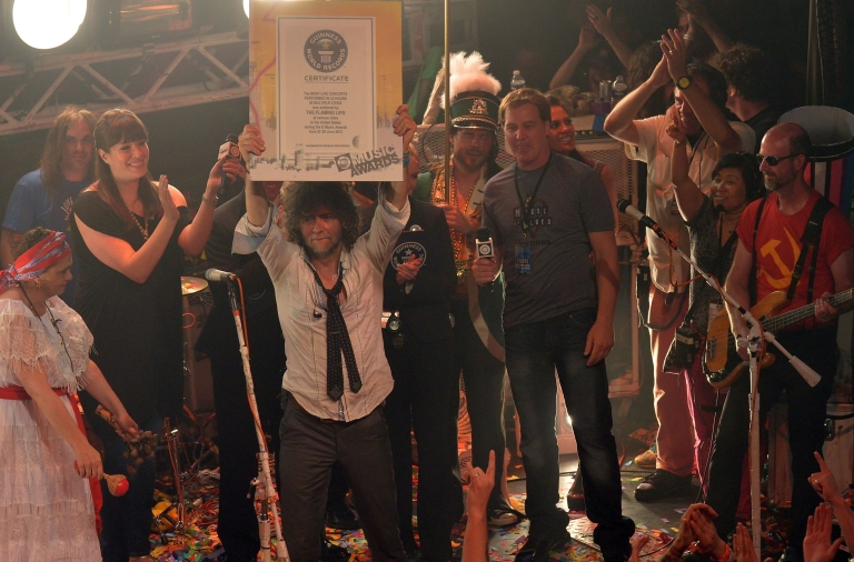 <p>Wayne Coyne and The Flaming Lips accept a certificate from Amanda Mochan and Mike Janela from the Guinness World Records on stage during the conclusion of the MTV, VH1, CMT &amp; LOGO O Music Awards at the House of Blues on June 28, 2012 in New Orleans, Louisiana.</p>