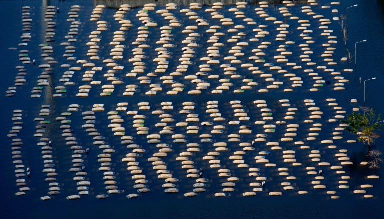 <p>Honda vehicles are seen in an aerial photo at the flooded Honda factory in the Rojuna Industrial district November 14, 2011 in Ayutthaya, Thailand.</p>