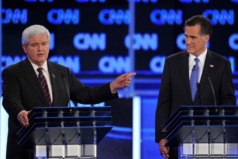 <p>Former House Speaker Newt Gingrich speaks as former Massachusetts governor Mitt Romney listens during an exchange at the Florida Republican Presidential debate January 26, 2012 at the University of North Florida in Jacksonville, Florida.</p>