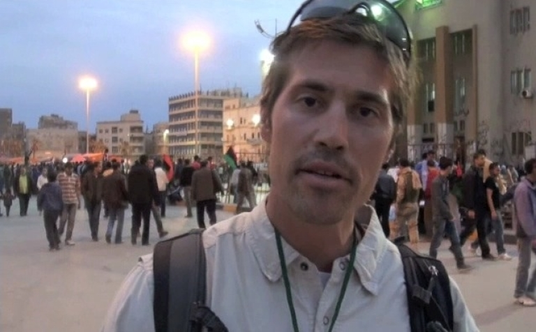 <p>Journalist James Foley reporting for GlobalPost from Benghazi, Libya in mid-March. Foley, along with three other foreign journalists, was detained by forces loyal to Libyan leader Muammar Gaddafi on April 5.</p>
