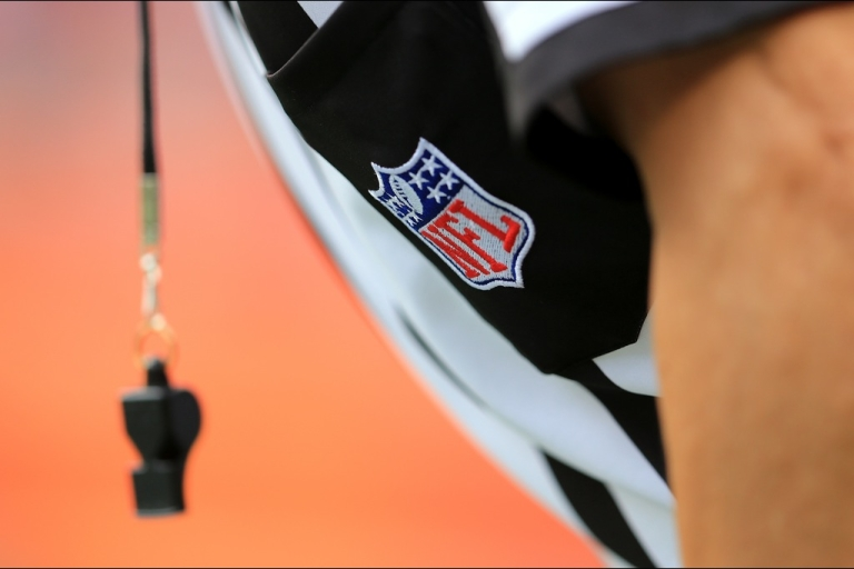 <p>A detail of the uniform and whistle of an NFL referee.</p>