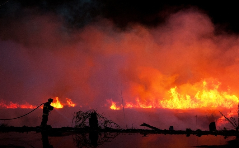 <p>A firefighter battles a brush fire in the Meadowlands near Metlife Stadium on April 11, 2012 in Carlstadt, New Jersey. Fire departments from around the area were on hand to bring under control one of many brush fires that have broken out in New Jersey and New York.</p>