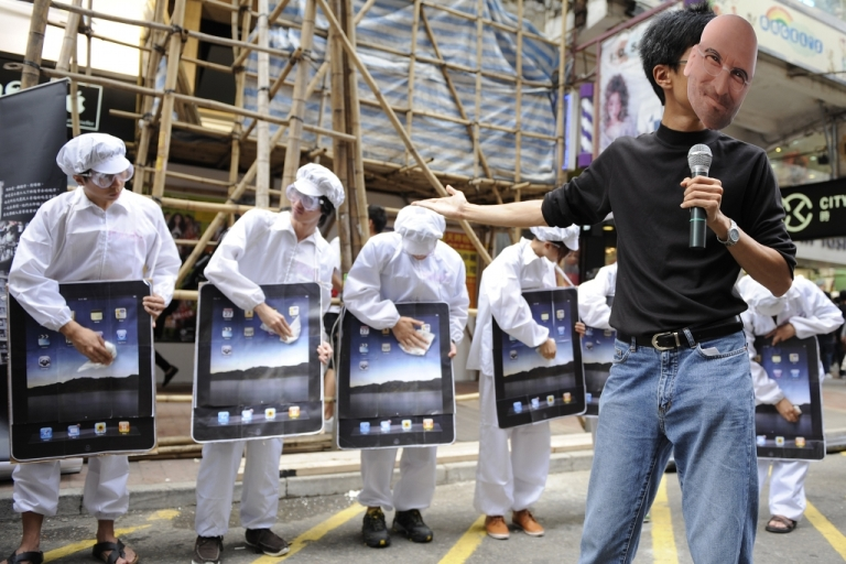 <p>An activist wearing a mask of former Apple CEO Steve Jobs takes part in a protest against Taiwanese technology giant Foxconn, which manufactures Apple products in China, outside an Apple retail outlet in Hong Kong on May 7, 2011.</p>