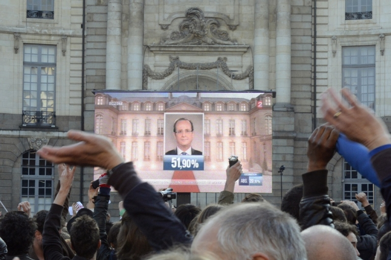 <p>Supporters of France's Socialist Party celebrate newly elected President Francois Hollande on May 6, 2012 in Rennes, western France, after the announcement of the first official results of the French presidential final round.</p>