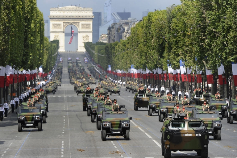 <p>French army armored vanguard vehicles (VAB) lead jeeps as they drive down the Champs-Elysees with the Arc de Triomphe in the background, during the annual Bastille Day parade in Paris, on July 14, 2011.</p>