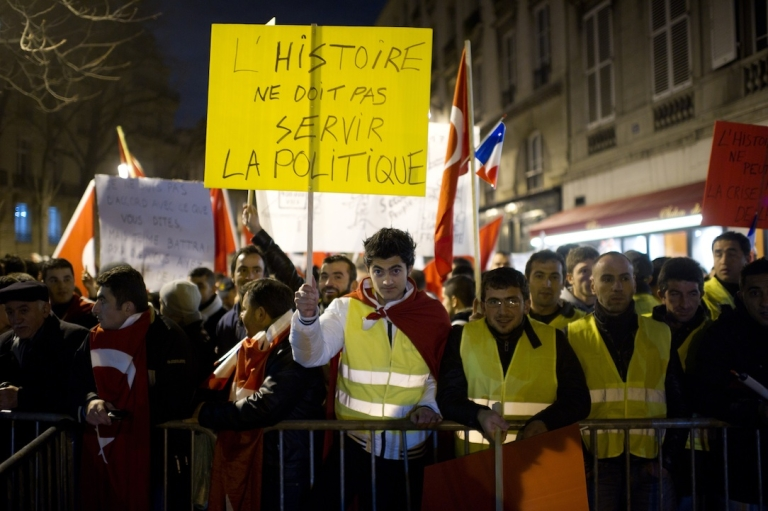 <p>Turks demonstrate next to the French National Assembly, at dawn on December 22, 2011 in Paris, France.</p>