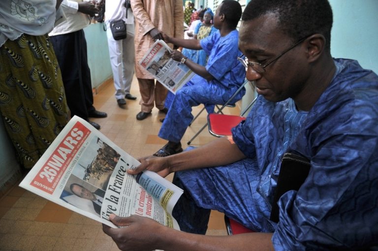<p>A Malian man reads a newspaper reading ''Long live France!'' as he waits to donate blood, on Jan. 14, 2013, in Bamako, Mali. France is in the middle of a military campaign in Mali to drive back advancing Islamist rebels.</p>