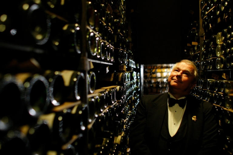 <p>David Ridgway, sommelier at Paris' famed 16th century eatery, the Tour d'Argent stands in the cellar of the restaurant on October 27, 2009. La Tour d'Argent famed for dishing up more than a million ducks, is putting 18,000 bottles up for auction on December 7 and 8, selected from 450,000 stocked in the cellars blessed with one of the best locations in the universe, straddling the Seine overlooking Notre Dame cathedral.</p>