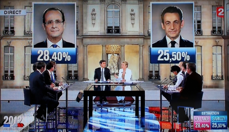 <p>French television shows the estimated results for the first round of the French 2012 presidential election that put Socialist challenger Francois Hollande and incumbent Nicolas Sarkozy through to the second round.</p>