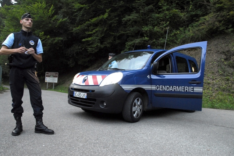 <p>French police block the road leading to the scene where four people were found shot dead.</p>