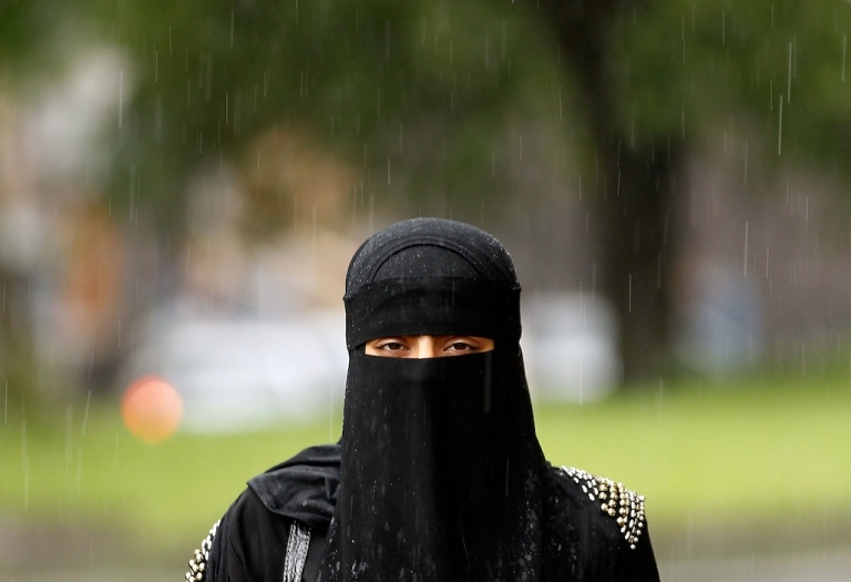 <p>A woman wears a full face Niqab on the streets of Blackburn July 20, 2010 in Blackburn, England. Syria has banned the wearing of full face veils in it's universities. The controversial Islamic niqab and the full face burqa has also seen calls across Europe for the garment to be banned. Many Islamic groups have called the ban discrimination against Muslims.</p>