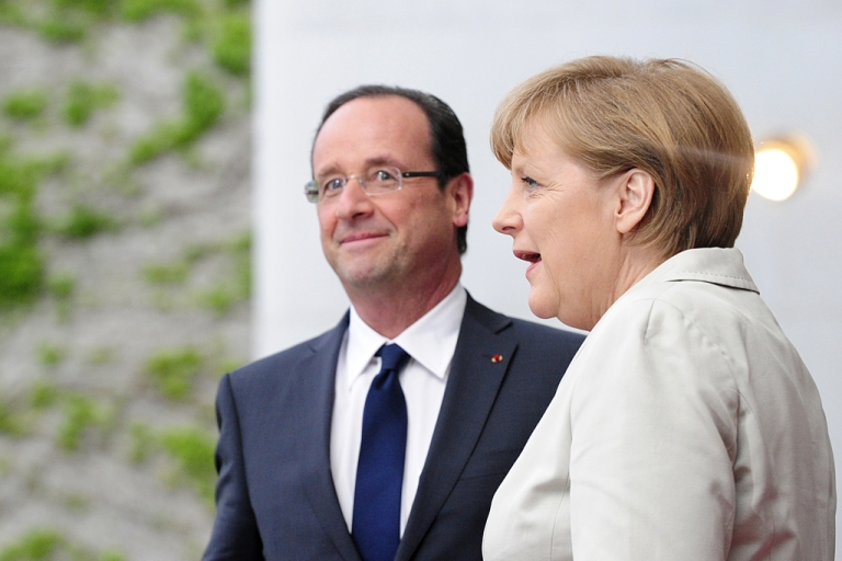 <p>German chancellor Angela Merkel speaks with the new French president Francois Hollande as she greets him at the German Chancellery on May 15, 2012 in Berlin. Lightning hit Hollande's plane as he flew for Berlin, forcing him to turn back, and delaying his arrival.</p>
