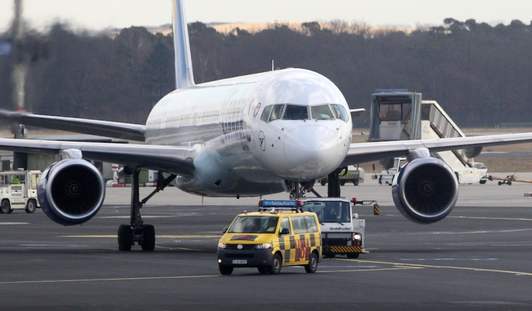 <p>Apron workers guide a jet at the airport in Frankfurt am Main, Germany, on February 20, 2012. Some 200 apron workers went on strike again in the morning for 48 hours forcing the cancellation of hundreds of flights. AFP PHOTO / DANIEL ROLAN</p>